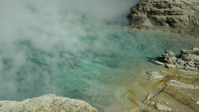 Wide high angle time lapse view of steam from Excelsior geyser / Yellowstone National Park, Wyoming, United States