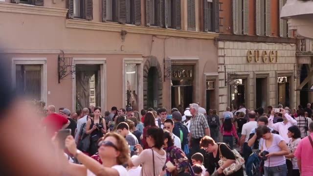 wide high angle view shoppers walk along via condotti on a sunny day in rome, italy, on monday, oct. 20 shoppers and tourists on via condotti,... - salvatore ferragamo stock videos & royalty-free footage