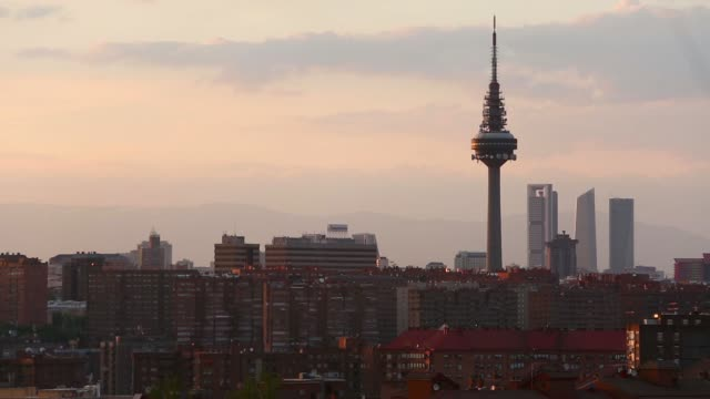 Wide high angle views of the city skyline at sunset in Madrid Spain on Thursday May 8 The Torrespana television tower stands on the city skyline in...