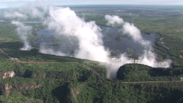 wide moving aerial footage of the victoria falls - victoria falls stock videos and b-roll footage