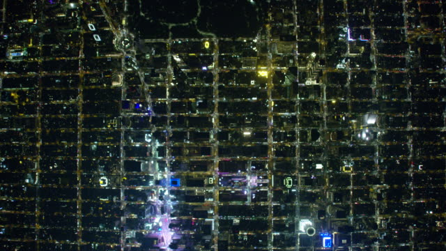 wide night aerial view of new york city and manhattan streets in midtown - central park manhattan video stock e b–roll