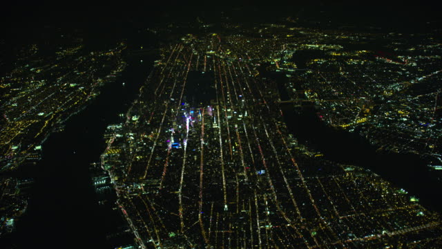 wide night aerial view of new york city and midtown manhattan - east river stock videos & royalty-free footage