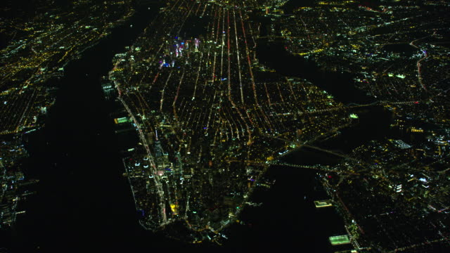 wide night aerial view of new york city - wide stock videos and b-roll footage