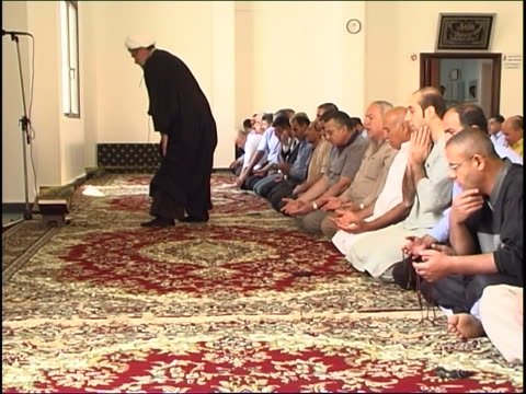 wide of a shia sheikh prostrating himself and leading the prayer in a mosque. - shi'ite islam stock videos & royalty-free footage