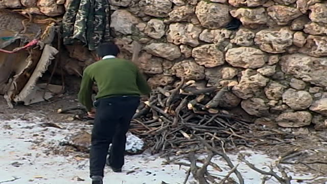 wide of a young man chopping wood from the kurdish village of kfarbe known in turkish as gungoren - chopping stock videos & royalty-free footage