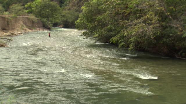 """Wide of man fishing with net in middle of Utcubamba River [Rio Utcubamba], Peru [Perú]"""