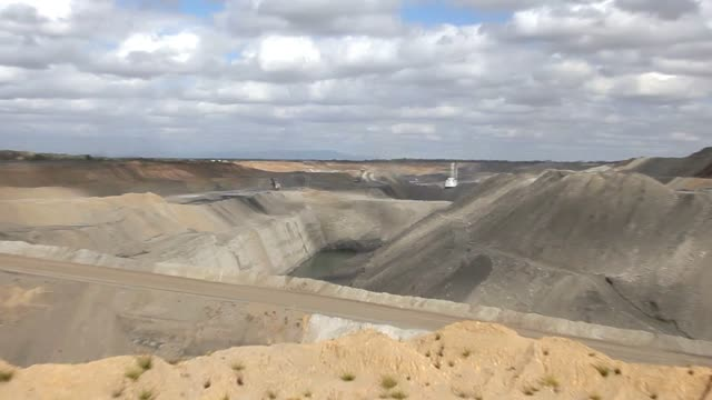 wide open-pit coal mine - dump truck stock videos and b-roll footage