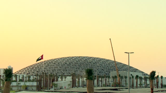 Wide outdoor shot of the Louvre Abu Dhabi during final construction