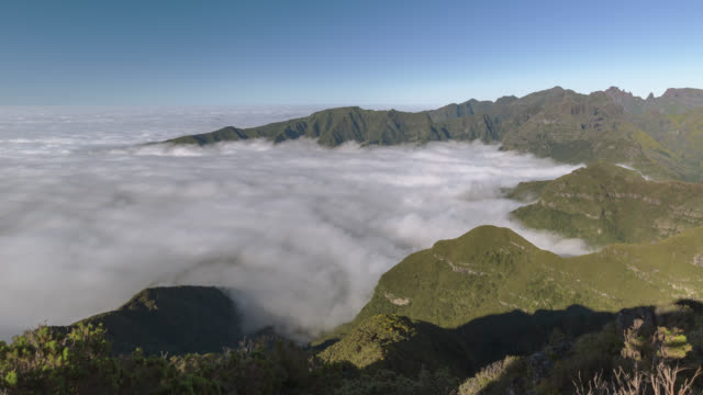 Wide pan across a sea of rolling clouds