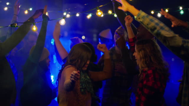 wide pan across group young adults dancing to dj (slo-mo) - dj stock videos & royalty-free footage
