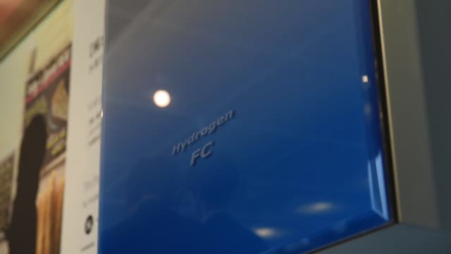wide pan left to right, and medium shot, a panasonic corp. solar hydrogen generation device is displayed at the wonder life-box showcase, medium tilt... - fuel and power generation stock-videos und b-roll-filmmaterial