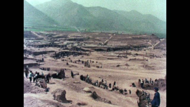 wide pan of reservoir construction site in china; 1973 - maoism stock videos & royalty-free footage