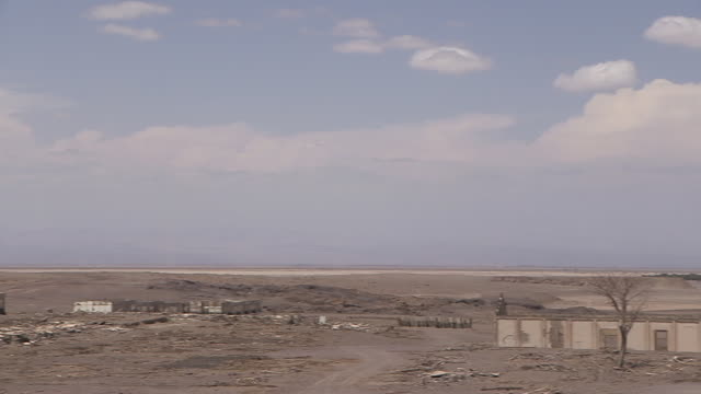 wide pan over abandoned buildings in the atacama desert, chile. - atacama region stock videos & royalty-free footage