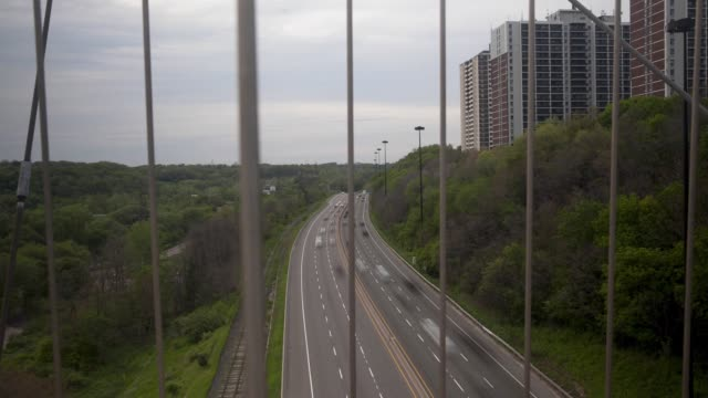 wide pan right timelapse of traffic on the don valley parkway in toronto ontario canada on june 24 2017 - two lane highway stock videos & royalty-free footage