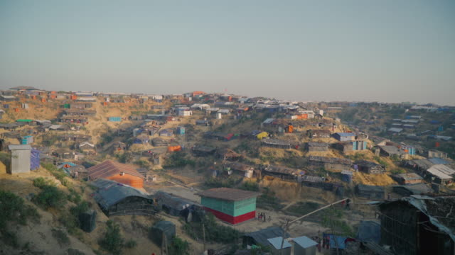 Wide pan right vista of Kutupalong refugee camp in Bangladesh at sunset Fleeing persecution by the Myanmar government and Rakhine vigilantes the...