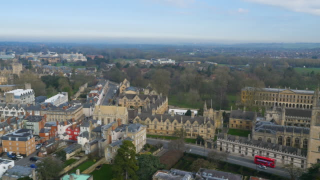 wide panning aerial drone footage from magdalen college to oxford - oxford england stock videos & royalty-free footage