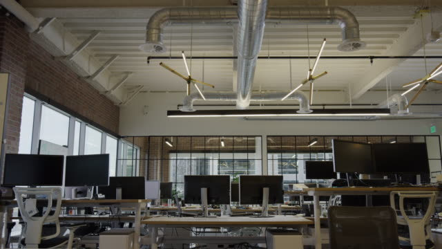 "stockvideo's en b-roll-footage met ""wide panning low angle shot of empty office / lehi, utah, united states"" - wide shot"