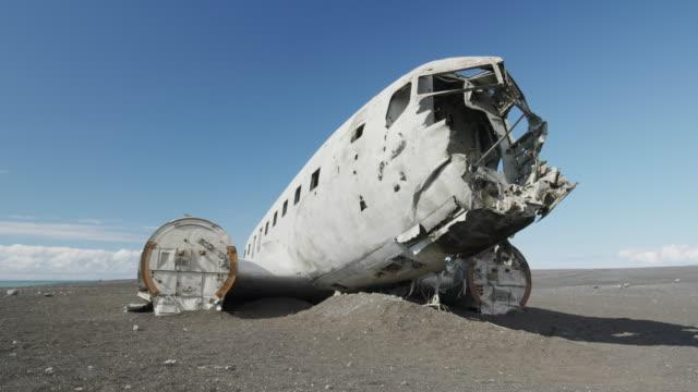 Wide panning shot of airplane wreckage in remote landscape / Vestur-Skaftafellssysla, Iceland