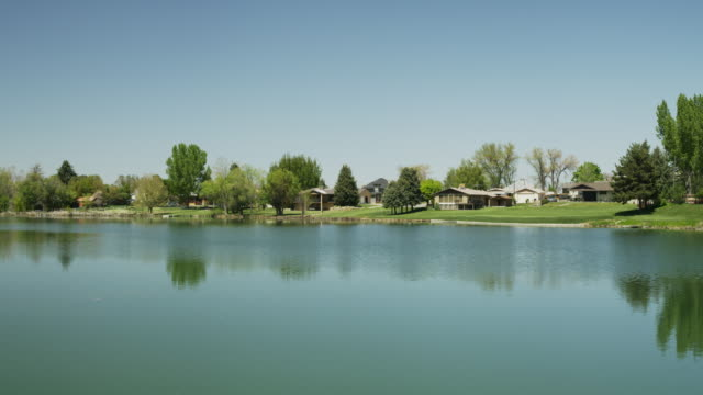 wide panning shot of distant houses at lakes / salem, utah, united states - wide stock videos & royalty-free footage