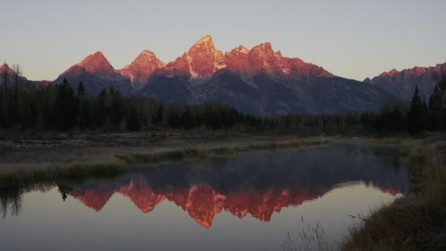 wide panning shot of mountain reflection in river / grand teton national park, wyoming, united states - grand teton national park stock videos & royalty-free footage