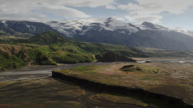 wide panning shot of river flowing near mountain range / thorsmork, rangarvallasysla, iceland - wide stock videos and b-roll footage
