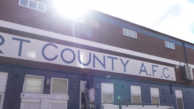 wide panning shot of stockport county fc's edgeley park ground - taking a shot sport stock videos & royalty-free footage