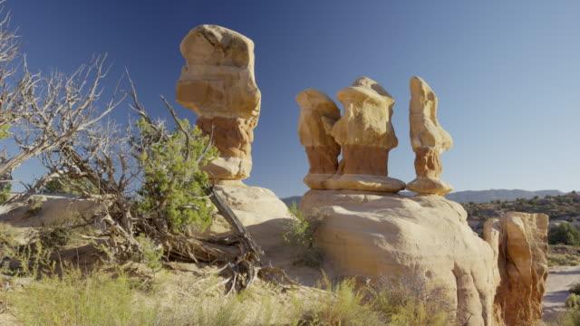 wide panning shot of unusual rock formations / escalante, utah, united states - escalante stock-videos und b-roll-filmmaterial