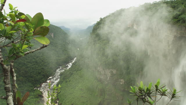 wide panning shot river valley through jungle and kaieteur falls waterfall - guyana stock videos & royalty-free footage