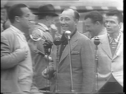 wide panning shots of the crowd looking on and pan to stage as the super war bond salesmen auction off items for war bonds including marlene... - horseshoe stock videos and b-roll footage