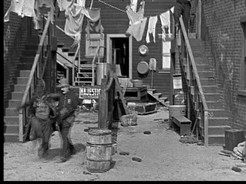 1918 b/w wide policeman beating man in alley - 1918 stock videos & royalty-free footage