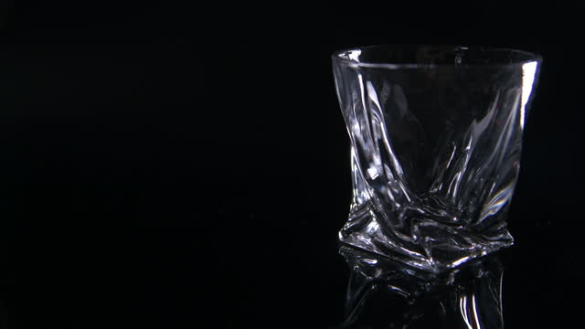 wide pull focus to modern whiskey tumbler - fade out video transition stock videos & royalty-free footage