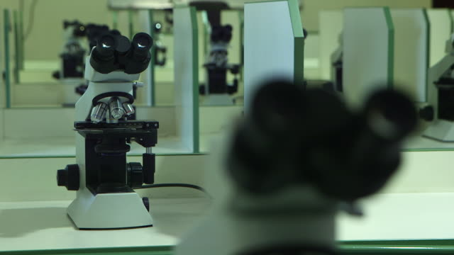 wide rackfocus on a microscope - magnification stock videos & royalty-free footage