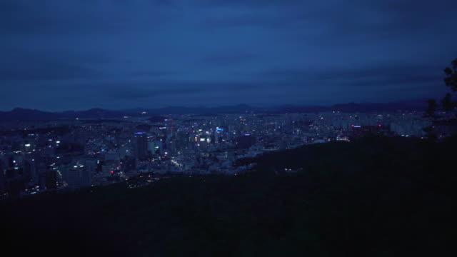 vidéos et rushes de wide, scenic seoul cityscape at dusk - panning