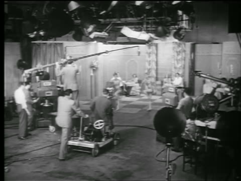 b/w 1948 wide shot 2 women dance in nbc tv studio surrounded by cameras + booms + production people - nbc stock videos & royalty-free footage