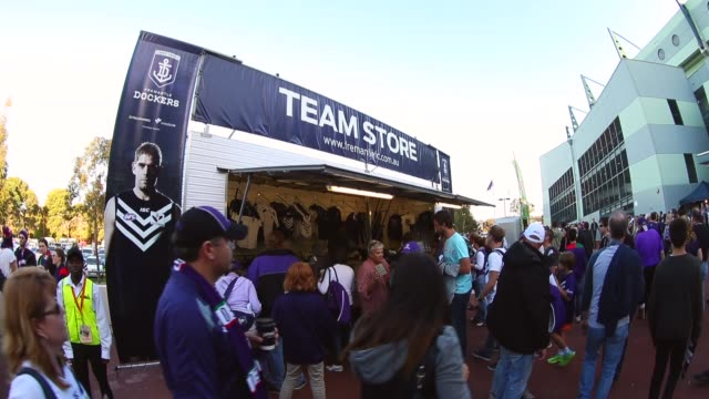 Wide Shot A mobile team store sells merchandise outside Patersons Stadium