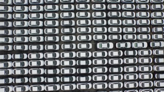 wide shot, aerial, birds eye view, flying overhead hyundai motor co vehicles bound for export waiting to board a hyundai glovis co roll-on/roll-off... - automobilindustrie stock-videos und b-roll-filmmaterial