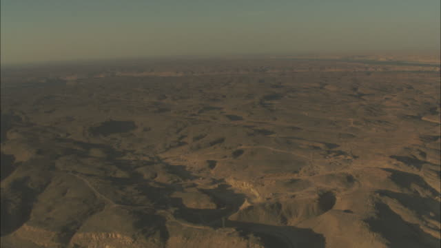 Wide Shot, aerial - Endless hills form a relief in the Egyptian desert