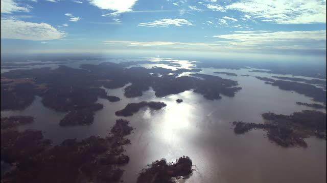 wide shot aerial , marshlands reflect a bright sky. / charlotte, north carolina, usa - marsh stock videos & royalty-free footage