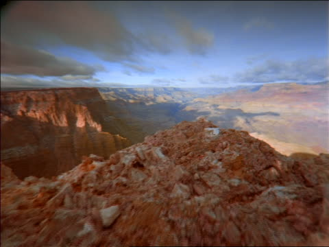 wide shot aerial or walking point of view toward grand canyon with time lapse clouds above / arizona - punto di vista di un passante video stock e b–roll