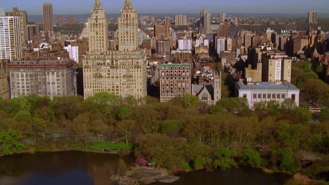 wide shot aerial over central park facing central park west / manhattan, nyc - upper west side manhattan stock videos and b-roll footage