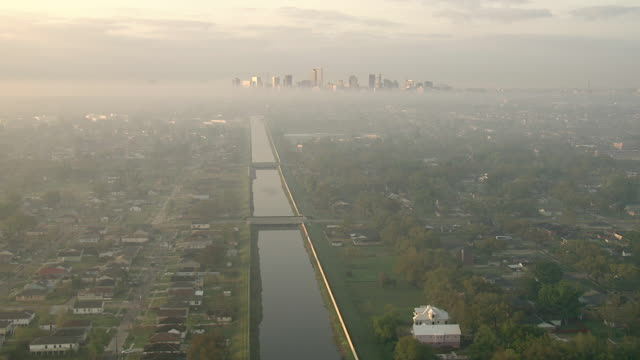 stockvideo's en b-roll-footage met wide shot aerial push-in - bridges span the canal that leads toward downtown new orleans. / new orleans, louisiana, usa - 2010