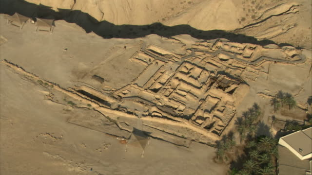 Wide Shot aerial push-in push-out tracking-right zoom-in - A system of grids marks an archaeological dig site in Israel. / Israel