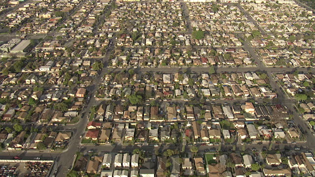 wide shot aerial tracking-left zoom-in - endless suburbs fill the landscape. / los angeles, california, usa - southern california stock videos & royalty-free footage
