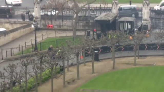 Wide shot and aerial view of paramedics coming to the aid of both the perpetrator and victims of the Westminster terror attack