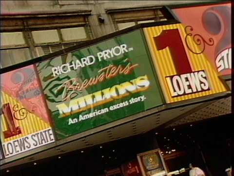 """wide shot and close up of a movie theater marquee reading """"brewster's millions,"""" and """"kurt thomas in gymkata"""" - music or celebrities or fashion or film industry or film premiere or youth culture or novelty item or vacations点の映像素材/bロール"""
