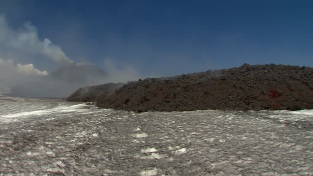 wide shot and close-up of a lava flow on mount etna - boulder rock stock videos & royalty-free footage