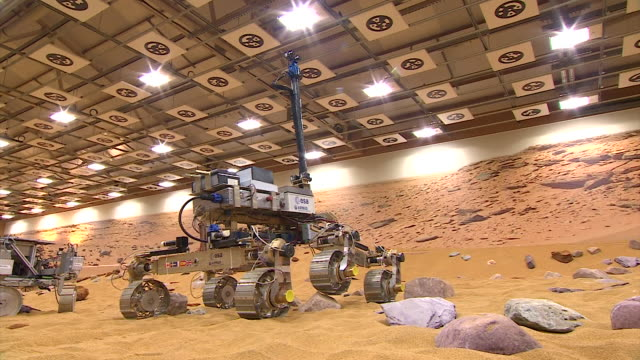 vidéos et rushes de wide shot and close-up on the wheels of the esa's exomars rover moving over rocks as it practices for the martian terrain - science et technologie