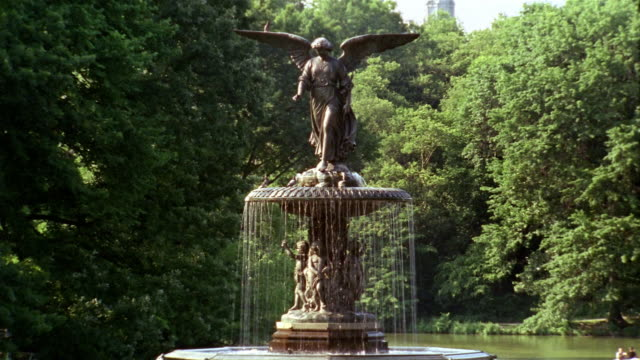 Wide shot 'Angel of the Waters' statue in Bethesda Fountain / Central Park / New York City