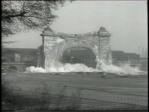 b/w 1959 wide shot arched facade of train station collapsing / berlin - 1950 1959 stock videos and b-roll footage