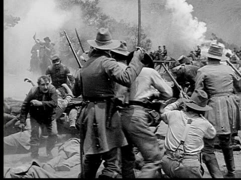 1913 reenactment b/w wide shot army officers and soldiers sword fighting while horse mounted cavalry rides across bridge during civil war battle reenactment / usa  - 1913 stock videos & royalty-free footage